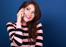 Beautiful makeup excited woman talking on mobile phone and with Royalty Free Stock Photos