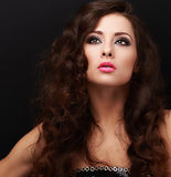 Beautiful makeup fashion model looking up with smokey eyes Royalty Free Stock Photography