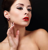 Beautiful makeup female model with black eyeliner and red lipstick. Closeup Royalty Free Stock Photo