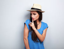 Beautiful makeup female model in summer casual hat showing secre Royalty Free Stock Images