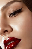 Beautiful makeup in Hollywood image with red lips. Close up beauty face Stock Images