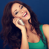 Beautiful makeup laughing woman talking on mobile phone on brigh Royalty Free Stock Photo