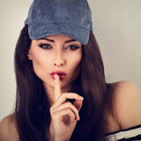 Beautiful makeup long hair woman in blue baseball cap showing si Stock Photos