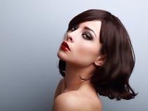 Beautiful makeup profile of black hair woman on blue Royalty Free Stock Image