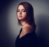Beautiful makeup sexy woman with calm emotions in black shirt on Royalty Free Stock Photos