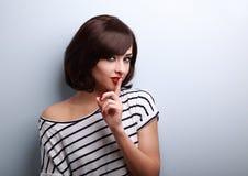 Beautiful makeup short hair woman showing silence sign Royalty Free Stock Images