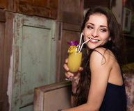 Beautiful makeup smiling woman drinking cocktail in night vintage. Bar Stock Photos