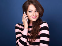 Beautiful makeup success woman talking on mobile phone on bright Stock Images