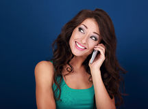 Beautiful makeup thinking woman talking on mobile phone on brigh Stock Photos