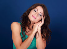 Beautiful makeup tired woman want to sleep and she lying on her Royalty Free Stock Image