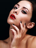 Beautiful makeup woman with bright red lips and black manicured Royalty Free Stock Images