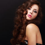 Beautiful makeup woman with curly hair looking Stock Images