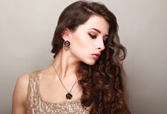 Beautiful makeup woman with long bright curly hair Stock Images