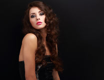 Beautiful makeup woman with long curly hair looking Stock Images