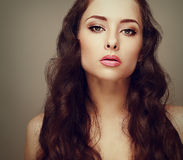 Beautiful makeup woman with long curly hair Royalty Free Stock Photography