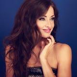 Beautiful makeup woman with long volume hairdo on bright blue ba Stock Photos