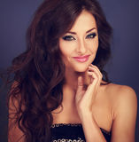 Beautiful makeup woman with long volume hairdo and hand near fac Royalty Free Stock Photo