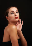 Beautiful makeup woman looking up on black. Background Stock Image