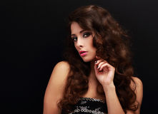 Beautiful makeup woman with manicure hand and long curly hair Stock Photography
