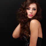 Beautiful makeup woman posing with long curly hair Stock Photography