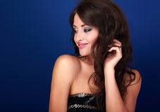 Beautiful makeup woman profile with long volume hairdo and hand Stock Photography