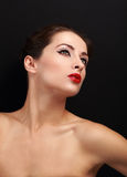 Beautiful makeup woman with red lips looking up Stock Images