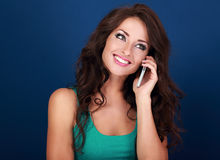 Beautiful makeup woman talking on mobile phone on bright blue ba Royalty Free Stock Photography