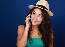 Beautiful makeup woman talking on mobile phone in summer hat on Royalty Free Stock Photo