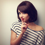 Beautiful makeup young woman showing silence sign. Short hair st Royalty Free Stock Photo