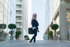 Beautiful Malay girl wearing suit outdoor royalty free stock photography
