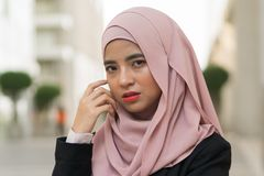 Beautiful Malay girl wearing suit outdoor stock photography