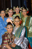 Beautiful malay girls. Young beautiful girls in traditional costumes giving a pose Royalty Free Stock Images