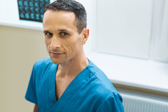 Beautiful male doctor looking at the camera Royalty Free Stock Photos