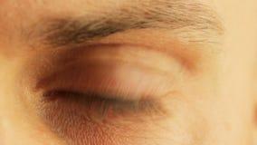 Beautiful male eye close-up stock footage