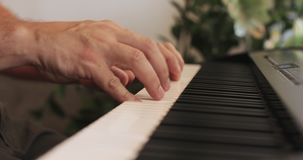 Beautiful male hands playing the piano. Close-up. stock video