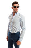 Beautiful male model wearing open shirt and tight pants. Beautiful male model wearing open shirt, tight pants and sunglasses Royalty Free Stock Photo