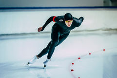 Beautiful male skater during race sprint distance along path of ice Palace Stock Photos