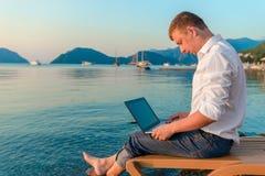 Beautiful male working outdoors Stock Image