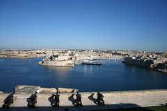 Beautiful Malta. View from Malta Castle with cannons: Valetta Harbor on the island of Malta, expensive yachts in the bay. They are part of the unique atmosphere Royalty Free Stock Photos