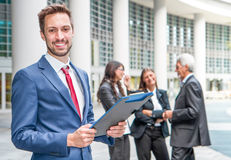 Beautiful man on the background of business people Stock Photography