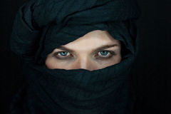 Beautiful man with black scarf. Eyes of a beautiful man with black scarf royalty free stock images