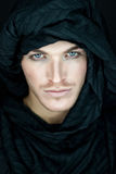 Beautiful man with black scarf. Eyes of a beautiful man with black scarf royalty free stock photography