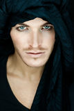 Beautiful man with black scarf. Eyes of a beautiful man with black scarf stock photo