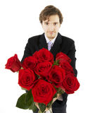 Beautiful man with a bouquet of roses Royalty Free Stock Image