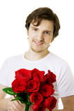 Beautiful man with a bouquet of roses Royalty Free Stock Photography
