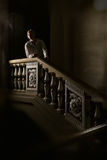Beautiful man in the clothing of the 18th century. In a interior with stairs Royalty Free Stock Photography