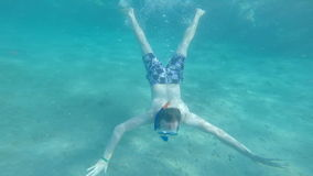 Beautiful man diving in the warm cyan water. summer and vacation. active lifestyle. Healthy exercise stock video