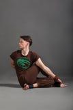 Beautiful man doing yoga  marichiasana. Beautiful man doing yoga on a white background Stock Photography