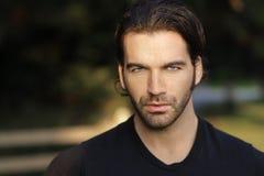 Beautiful man face. Portrait of  a beautiful man outdoors Stock Image