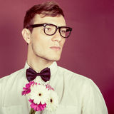 Beautiful man with flowers Stock Photography